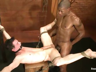 Black dude with huge muscles is abusing a white...
