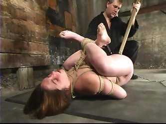 Hog tied Ginger gets her vagina stuffed with a...