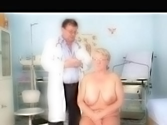 Doctor Examines The Chubby Older...